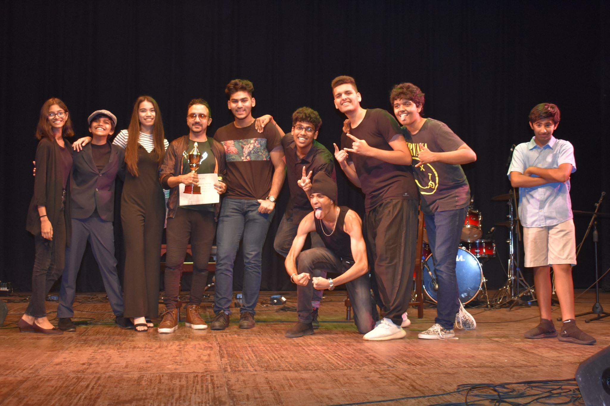 Music Director Ram Sampath gives away the best band award to The Mourning Mafia from RIMS International and Terabyte from Nahar International at the Battle of the Bands, Royal Opera House